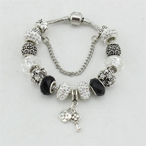 Black and White Beads and Charm Bracelet, Bangles. Silver plated.
