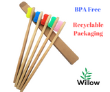 5 bamboo toothbrushes with coloured bristles and recyclable packaging