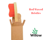 bamboo toothbrush with red medium waved bristles