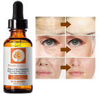 bottle of vitamin c serum with before and after images