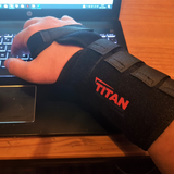 typing on laptop with wrist support brace on
