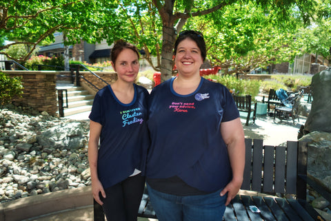 Two white women standing side by side demonstrating the fit of the breastfeeding tee