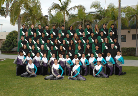band members with colorguard standing and smiling