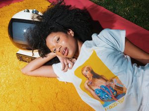 Ashara wears the 1-800-TWEETY tee in Size S