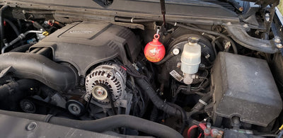Mini Fire Extinguisher Ball, tied under hood, near engine bay, car fire extinguisher, photo