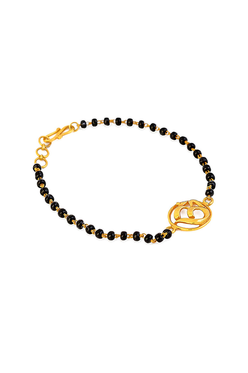 Handmade 18kt Gold OM & Faceted Black Onyx Bracelet