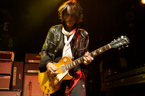 Joe Perry of Aerosmith hanging his Gibson Les Paul with his Red Monkey guitar strap.