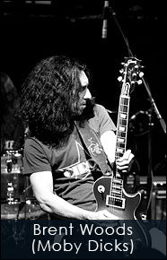 Brent Woods of the Moby Dicks playing his Les Paul guitar and Red Monkey guitar strap