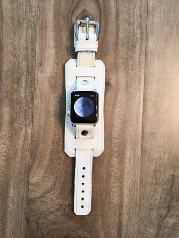 White leather Apple Watch band.