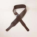"3"" inch wide brown leather guitar strap with white stitch."