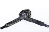 Black leather guitar strap with silver studs.  Pre-punched for strap locks upon request.