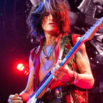Joe Perry live with his Red Monkey guitar strap.