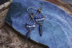Woven dangle earrings with labradorite, iolite, & silvered jet czech glass feathers