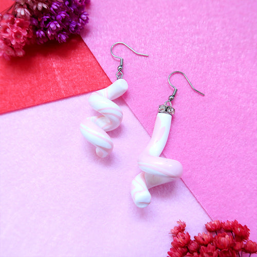 Asymmetric Baby Pink Swirl Earrings with crystal embellishments