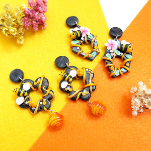 Two pairs of happy sunshine yellow bee with dangling hive polymer clay earrings with stud