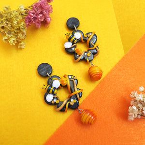 Happy sunshine yellow bee with dangling hive polymer clay earrings with stud