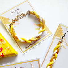 Load image into Gallery viewer, Instagram Featured Handmade yellow and gold braided polymer clay bracelet