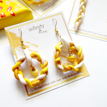 Load image into Gallery viewer, Instagram Featured Handmade yellow and gold braided polymer clay earrings