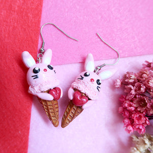 Sweet pink bunny icecream polymer clay earrings holding a heart
