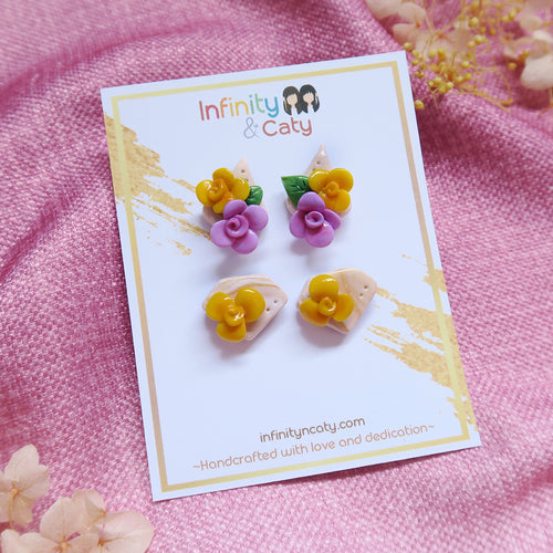 Buzz buzz floral sunshine yellow and pretty purple floral with leaves stud pack
