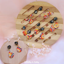 Load image into Gallery viewer, Bright cane technique polymer clay Color Fiesta Earrings with midnight black studs with gold flakes combined