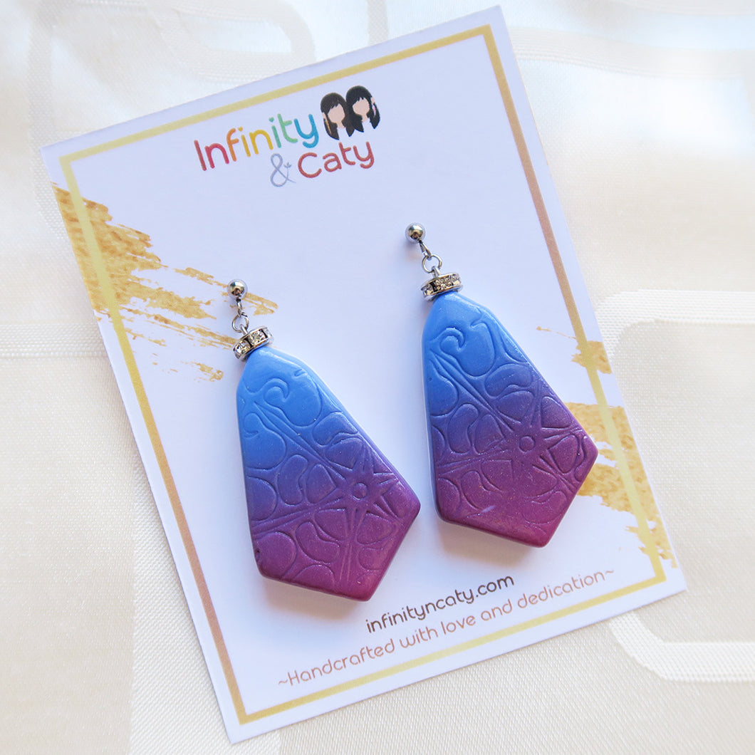 Polymer clay gradient blue to violet imprints with crystal crown earrings
