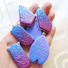Load image into Gallery viewer, Handmade Polymer clay gradient blue to violet imprints with crystal crown earrings
