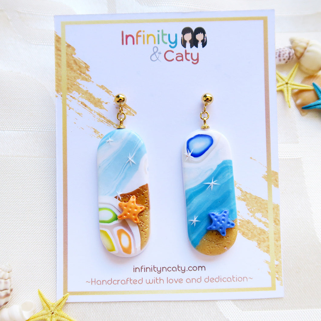 Handmade polymer clay earrings Singapore Santorini Vibes Earring that displays the pristine golden sand, clear blue water and skies of Santorini - Pill shape with orange and blue starfish