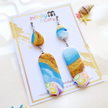 Load image into Gallery viewer, Polymer Clay Santorini Vibes Earring that displays the pristine golden sand, clear blue water and skies of Santorini