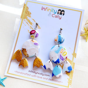 Polymer Clay Santorini Vibes Earring that displays the pristine golden sand, clear blue water and skies of Santorini - Circle, large circle and eggshell shaped