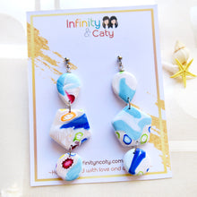 Load image into Gallery viewer, Polymer Clay Santorini Vibes Earring that displays the pristine golden sand, clear blue water and skies of Santorini - Teardrop, hexagon and circle shaped