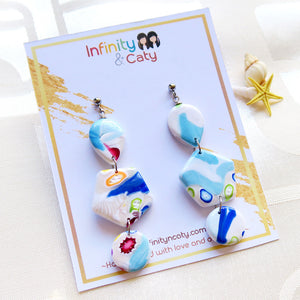 Polymer Clay Santorini Vibes Earring that displays the pristine golden sand, clear blue water and skies of Santorini - Teardrop, hexagon and circle shaped