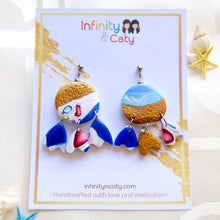 Load image into Gallery viewer, Polymer Clay Santorini Vibes Earring that displays the pristine golden sand, clear blue water and skies of Santorini - Unique dangle eggshell shaped