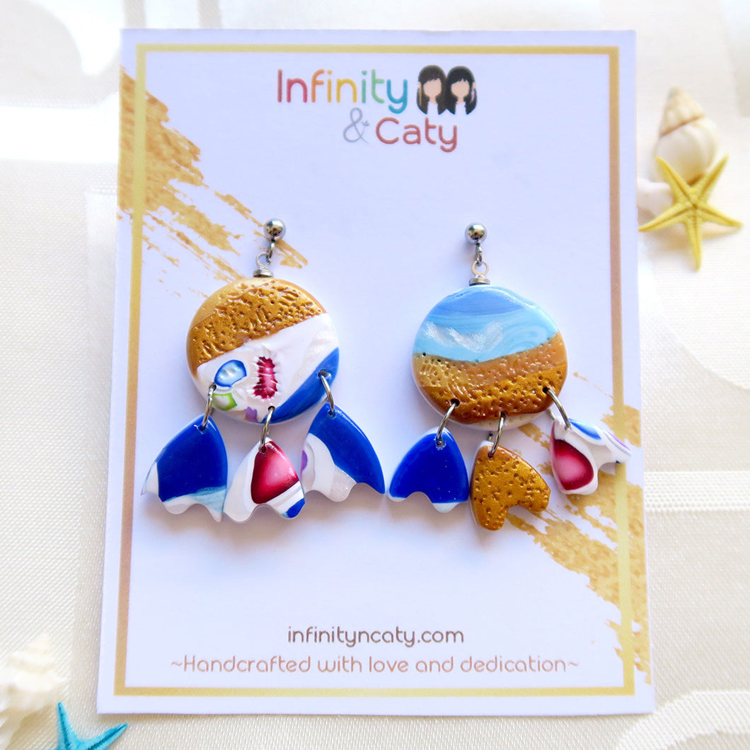 Polymer Clay Santorini Vibes Earring that displays the pristine golden sand, clear blue water and skies of Santorini - Unique dangle eggshell shaped