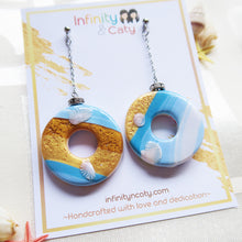 Load image into Gallery viewer, Polymer Clay Santorini Vibes Earring that displays the pristine golden sand, clear blue water and skies of Santorini double sided design