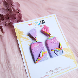 Polymer clay somewhere over the rainbow pastel pink purple with rainbow decorations and patterned earrings