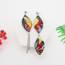 Load image into Gallery viewer, Splash - Unique pair of handmade polymer clay earrings that make you stand out in the crowd. Handmade in Singapore.