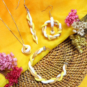 Combination of other designs of handmade yellow and gold braided polymer clay earrings, necklace and bracelet