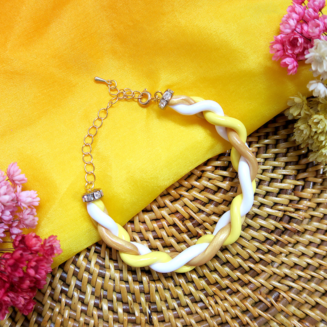Handmade yellow and gold braided polymer clay bracelet
