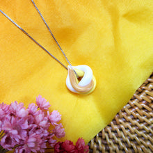 Load image into Gallery viewer, Handmade yellow and gold braided polymer clay pendant