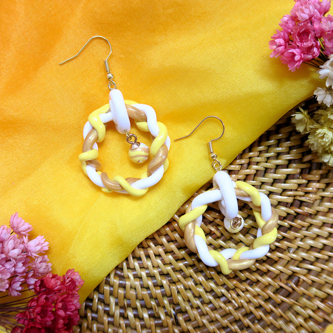 Handmade yellow and gold braided rounded polymer clay earrings