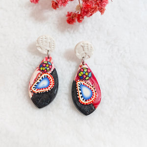 Unique pair of handmade polymer clay earrings that make you stand out in the crowd. Handmade in Singapore.