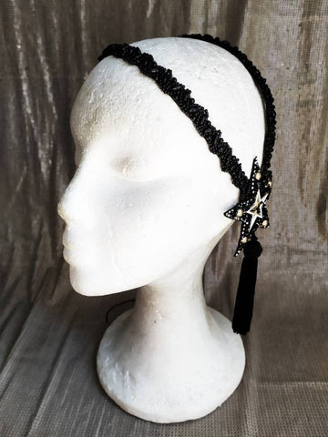 Gold and black sparkling star headpiece