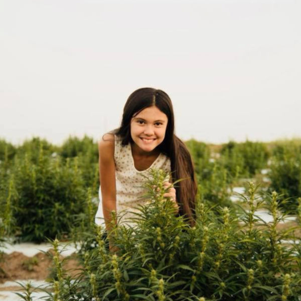Cannabis advocate Alexis Bortell smiling in Hemp field