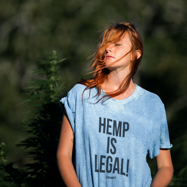 Model wearing hemp is legal hemp tee shirt in Hemp field in honor of the 2018 Farm Bill signing