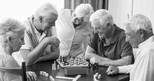 Group of elderly people playing chess