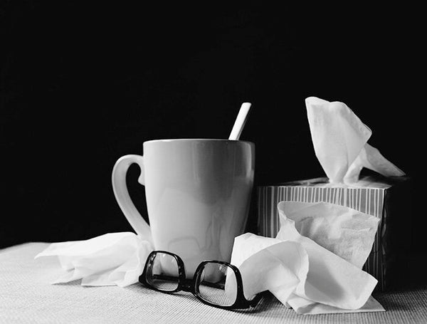 Glasses, coffee cup, tissues for flu season