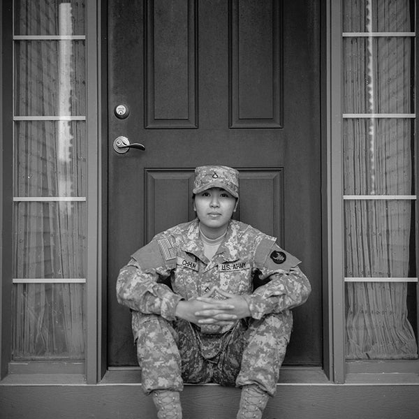 Female military personelle sitting in front of door