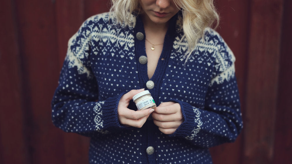 Girl holding Neurogan CBD salve