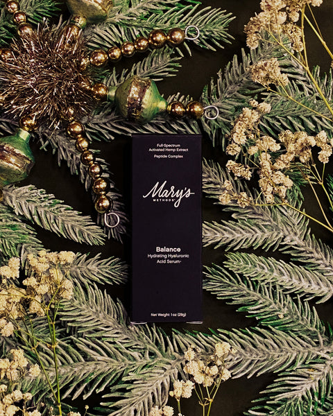 Mary's Nutritional's CBD Facial Serum laying on Christmas decorations
